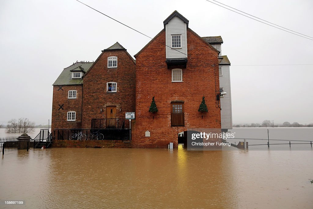 Tewkesbury at the confluence of the River Severn and the River Avon suffers flooding on December 24, 2012 in Tewkesbury, England. Forecasters have predicted more rain to sweep across the country causing flash flooding over the coming days. The South West of England has been badly affected causing major disruption to the rail network delaying journeys for people making their way home for Christmas.