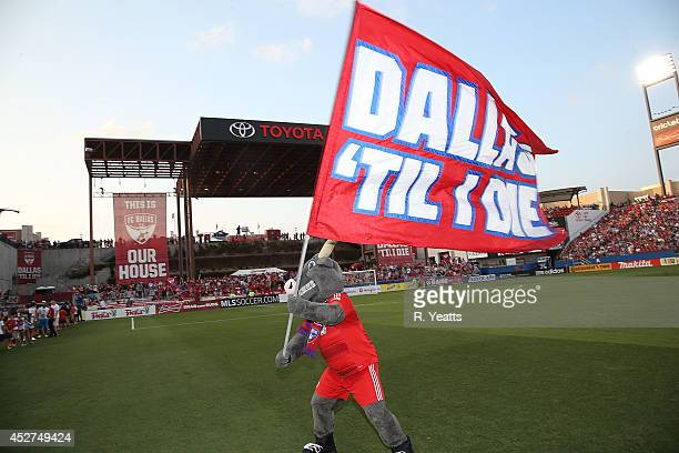 Tex Hooper waves his flag before FC Dallas takes on the Philadelphia Union at Toyota Stadium on July 4, 2014 in Frisco, Texas.