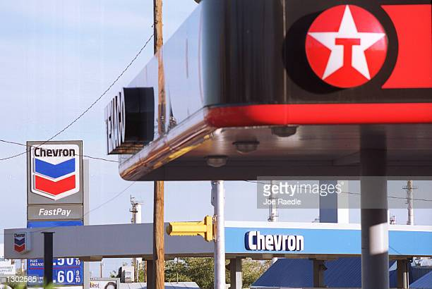 Texaco gas station and a Chevron gas station share the same block October 16 2000 in El Paso Texas Chevron Corp and Texaco oil companies have agreed...