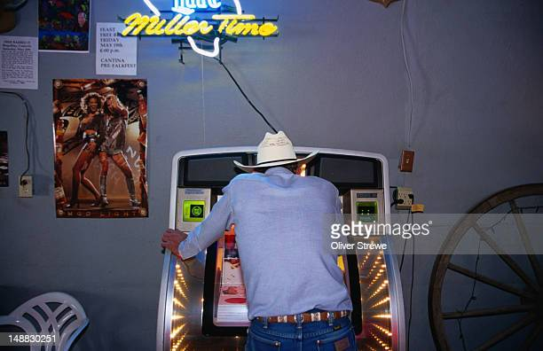 A Texan chooses a tune on the jukebox at the Dakota Cantina bar at Sanderson on Highway 80.