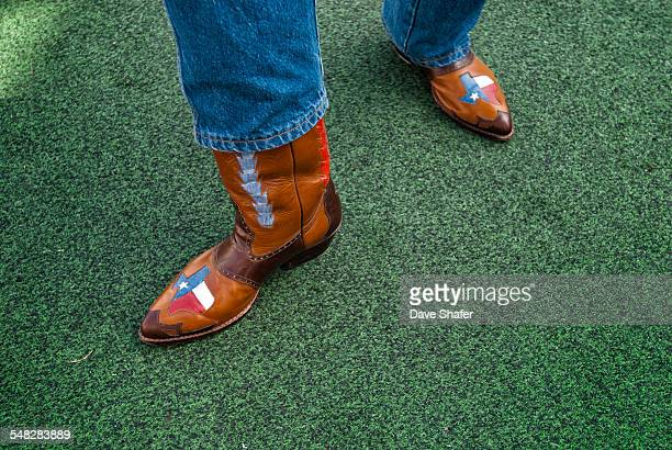 A Texan displays his pride of the lone star state with his custom cowboy boots.