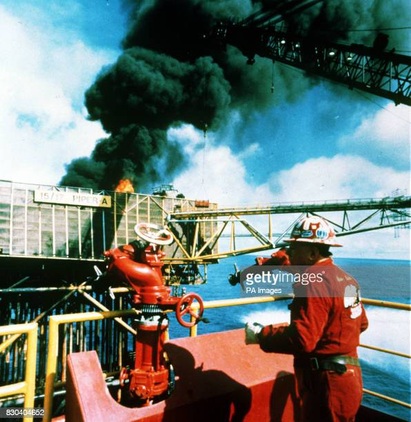 Texan expert fire fighter Red Adair on the stillburning Piper Alpha offshore platform before he was forced to retreat by a combination of a surge of...