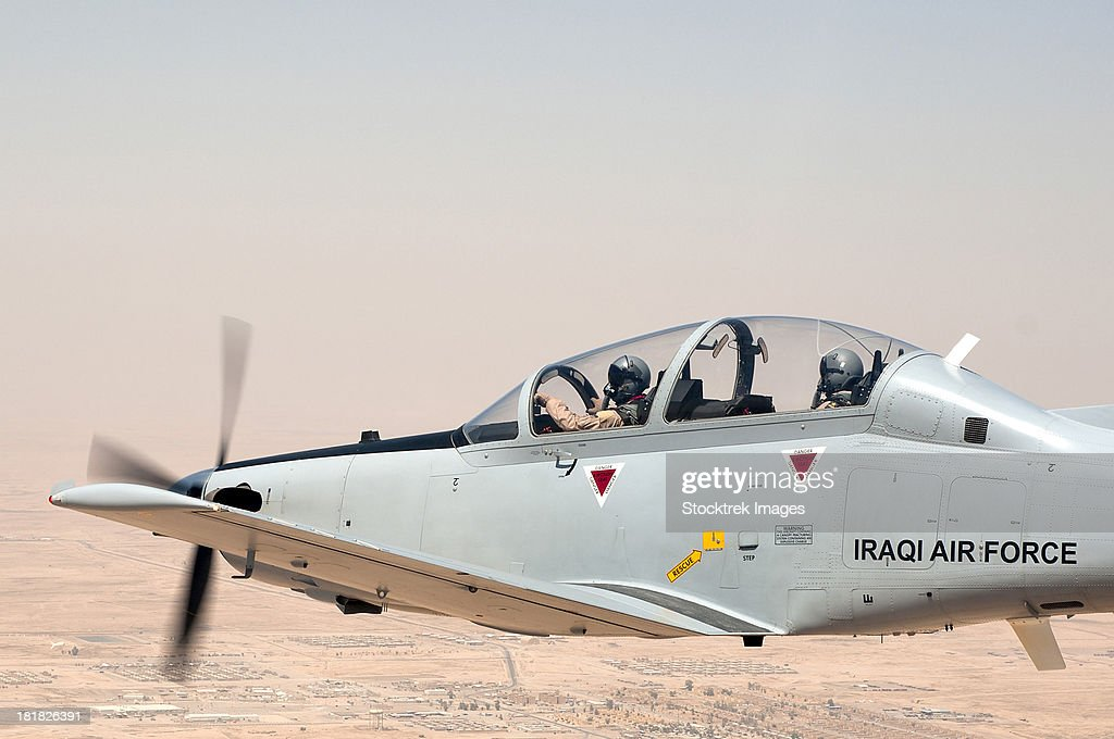 A T-6 Texan flying over Camp Speicher, Tikrit, Iraq. : Stock Photo