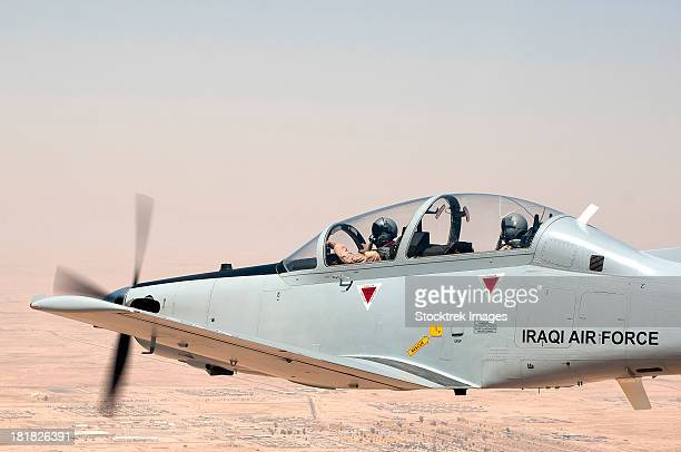 A T-6 Texan flying over Camp Speicher, Tikrit, Iraq.