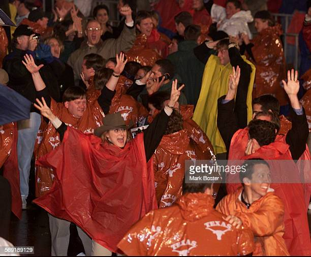 Texans and nother supporters celebrate in Austin Texas when it was announced that George W Bush won the election