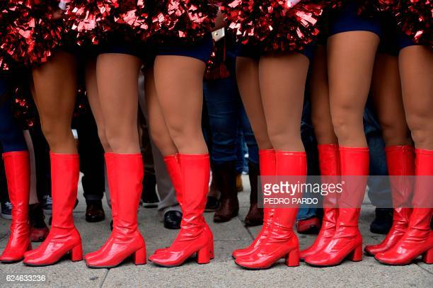 NFL Texans' cheerleaders pose in the roundabout of the Angel of the independence in Mexico City on November 20 2016 As the NFL returns to Mexico with...