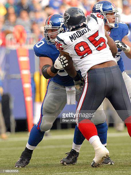Texans defensive tackle Anthony Maddox takes on Giants center Shaun O'Hara during the game between the New York Giants and the Houston Texans at...