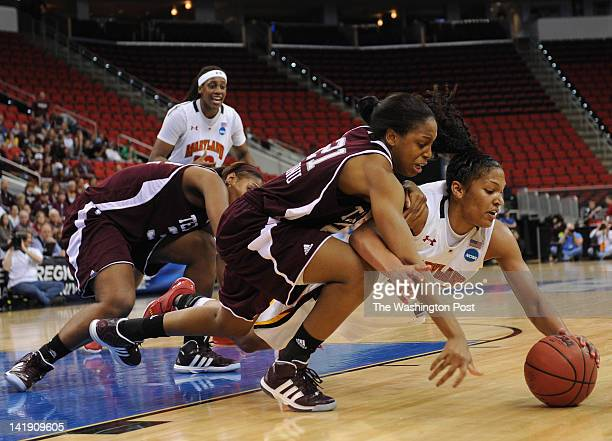 Texas AampM Aggies forward Adaora Elonu left get tangled up with Maryland Terrapins forward Alyssa Thomas as they battle for a loose ball under the...