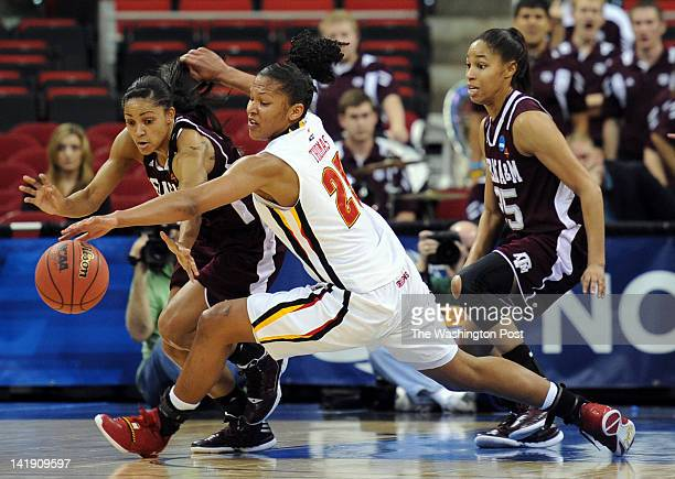 Texas AampM Aggies guard Sydney Carter left reaches in to steal the ball from Maryland Terrapins forward Alyssa Thomas during a Regional Semifinal...