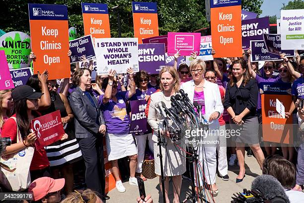 Texas abortion provider Amy HagstromMiller looks on as Nancy Northup President of The Center for Reproductive Rights speaks to the media outside of...