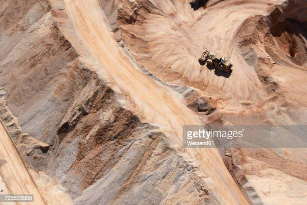usa, texas, aerial view of sand mine near san antonio with a grader moving sand - gruva bildbanksfoton och bilder