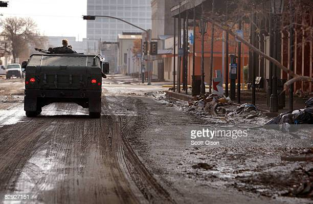 Texas Air National Guard convoy drives through the historic downtown district which was heavily damaged during Hurricane Ike September 20 2008 in...