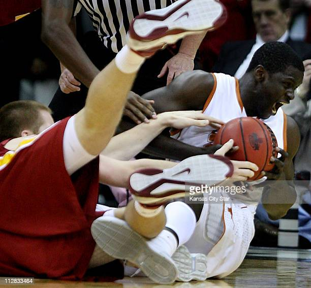 Texas' Alexis Wangmene came up with the ball after going to the floor with Iowa State's Justin Hamilton during the opening half of men's Big 12...