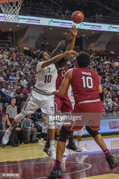 Texas AM Aggie center Tonny TrochaMorelos and South Carolina Gamecocks forward Khadim Gueye fight for a first half rebound during the basketball game...