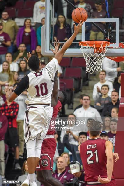 Texas AM Aggie center Tonny TrochaMorelos extends high above the basket for a first half finger roll during the basketball game between the South...