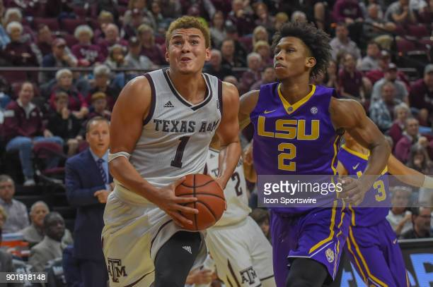 Texas AM Aggie forward DJ Hogg drives hard to the basket as LSU Tigers guard Brandon Rachal defends during the basketball game on January 6 2018 at...