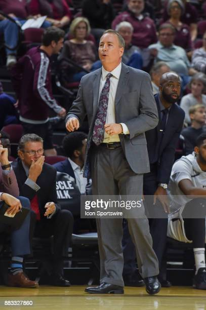 Texas AM Aggie head coach Billy Kennedy calls a play from the sideline during the basketball game between the University of Texas Rio Grande Vaqueros...