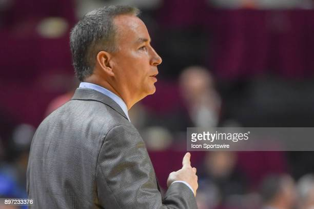 Texas AM Aggie head coach Billy Kennedy signals a play in from the sideline during the basketball game between the Buffalo Bulls and the Texas AM...