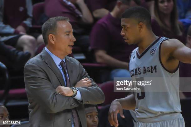 Texas AM Aggie head coach Billy Kennedy talks to Texas AM Aggie guard Savion Flagg during a ball stoppage during the basketball game between the...