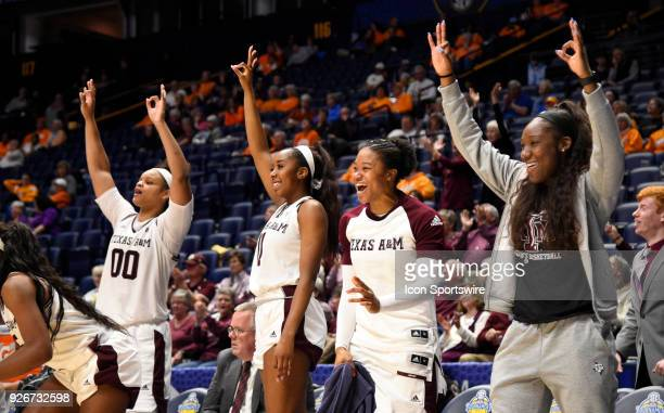 Texas AM Aggies bench holds up three fingers after Texas AM Aggies guard Chennedy Carter hits a three pointer during the fourth period between the...