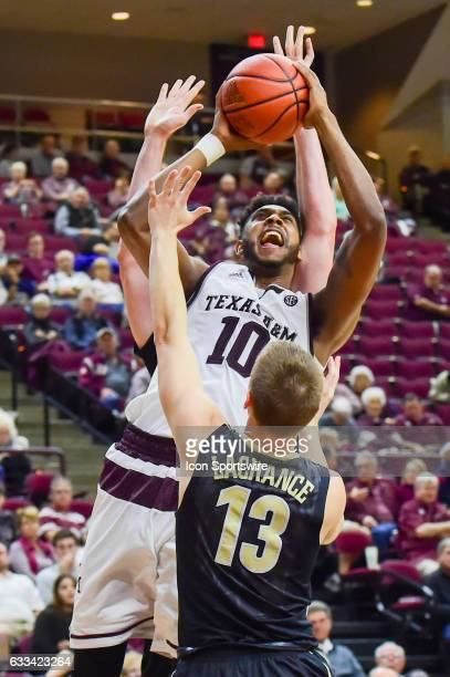 Texas AM Aggies center Tonny TrochaMorelos gets a shot off over Vanderbilt Commodores guard Riley LaChance during the SEC Men's basketball game...