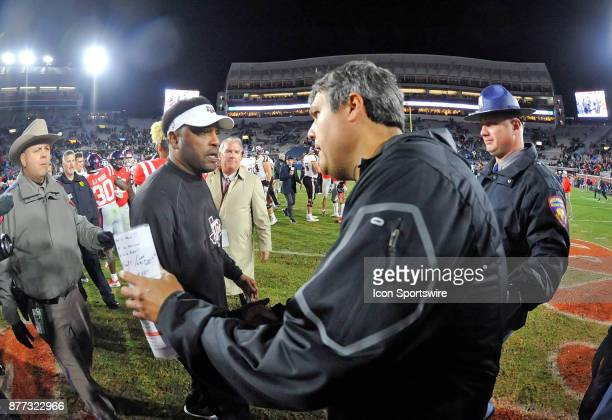 Texas AM Aggies coach Kevin Sumlin shakes hands with Mississippi Rebels interim coach Matt Luke after winning a NCAA college football game on...