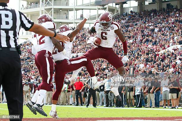 Texas AM Aggies defensive back Donovan Wilson celebrates an interception with teammates during the football game between Mississippi St and Texas AM...