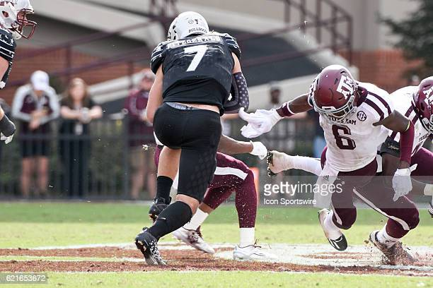 Texas AM Aggies defensive back Donovan Wilson misses an attempted tackle of Mississippi State Bulldogs quarterback Nick Fitzgerald during the...