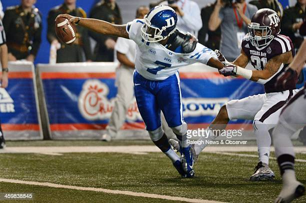 Texas AM Aggies defensive back Howard Matthews tries to keep Duke Blue Devils quarterback Anthony Boone from scoring during the second quarter of the...