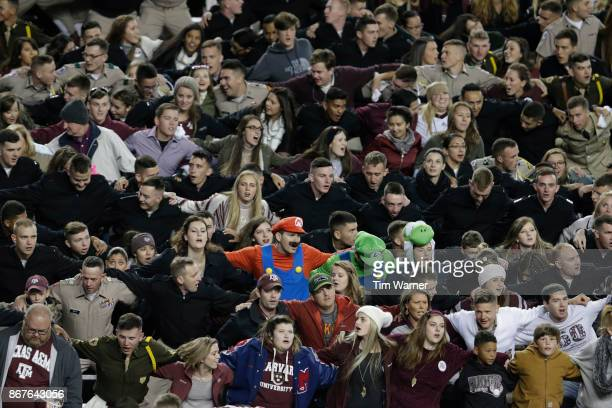 Texas AM Aggies fans sing in the fourth quarter of the game against the Mississippi State Bulldogs at Kyle Field on October 28 2017 in College...