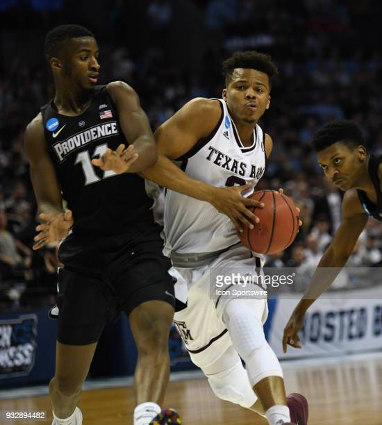 Texas AM Aggies guard Admon Gilder drives around Providence Friars guard Alpha Diallo during the NCAA Division I Men's Championship First Round game...