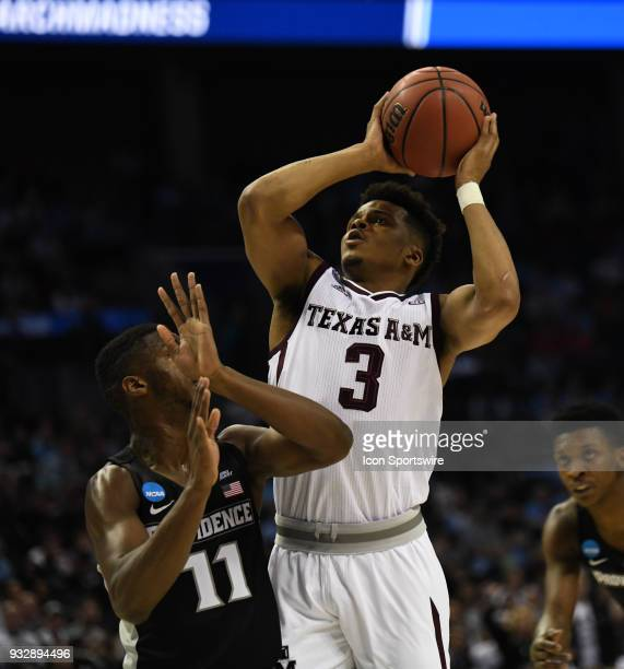 Texas AM Aggies guard Admon Gilder shoots over Providence Friars guard Alpha Diallo during the NCAA Division I Men's Championship First Round game...