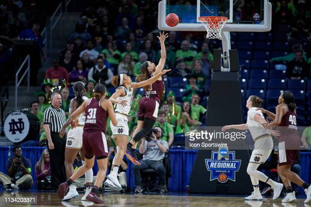 Texas AM Aggies guard Chennedy Carter battles with Notre Dame Fighting Irish forward Brianna Turner for a layup in game action during the Women's...