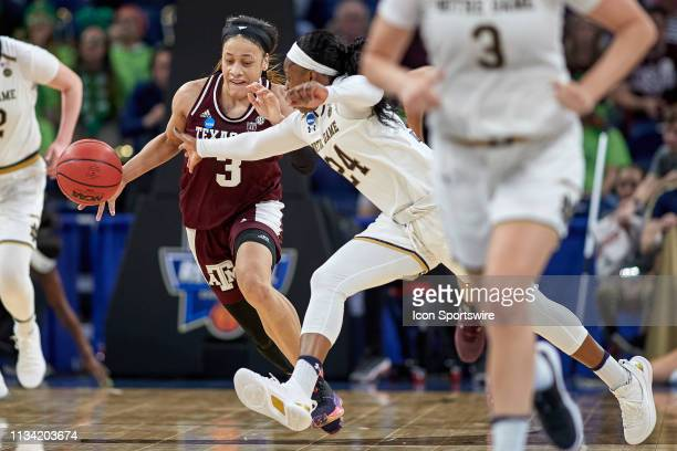 Texas AM Aggies guard Chennedy Carter battles with Notre Dame Fighting Irish guard Arike Ogunbowale in game action during the Women's NCAA Division I...