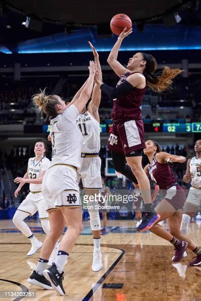 Texas AM Aggies guard Chennedy Carter battles with Notre Dame Fighting Irish guard Marina Mabrey and Notre Dame Fighting Irish forward Brianna Turner...