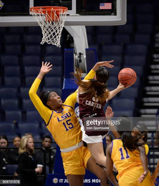 Texas AM Aggies guard Chennedy Carter drives the lane and shoots over LSU Tigers forward/center Yasmine Bidikuindila during the second period between...