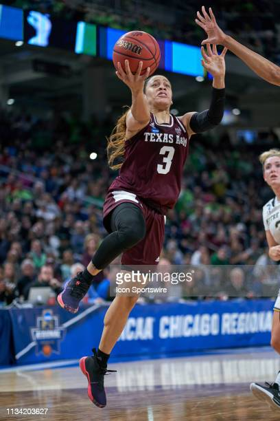 Texas AM Aggies guard Chennedy Carter goes up for a layup in game action during the Women's NCAA Division I Championship Third Round game between the...