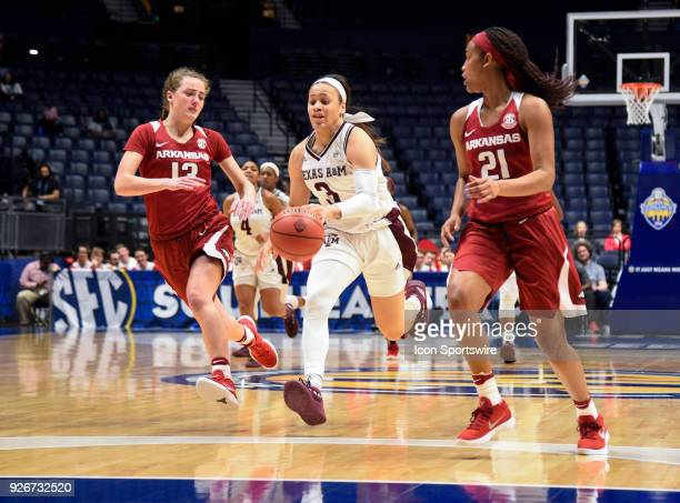Texas AM Aggies guard Chennedy Carter pushes the ball on a fast break as Arkansas Lady Razorbacks guard Brenna McClure and Arkansas Lady Razorbacks...
