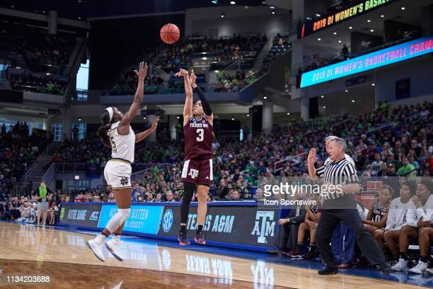 Texas AM Aggies guard Chennedy Carter shoots the ball past Notre Dame Fighting Irish guard Jackie Young in game action during the Women's NCAA...