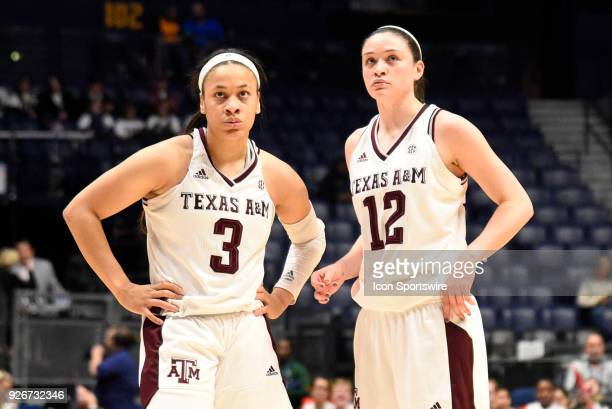 Texas AM Aggies guard Danni Williams and Texas AM Aggies guard Chennedy Carter watch the replay against the Arkansas Lady Razorbacks during the third...