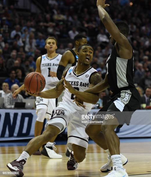 Texas AM Aggies guard TJ Starks drives around Providence Friars guard Alpha Diallo during the NCAA Division I Men's Championship First Round game...