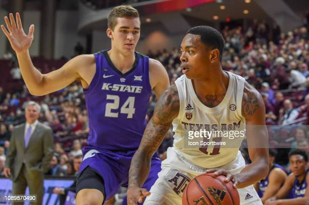 Texas AM Aggies guard Wendell Mitchell looks to advance the ball upcourt as Kansas State Wildcats forward Pierson McAtee defends during the...