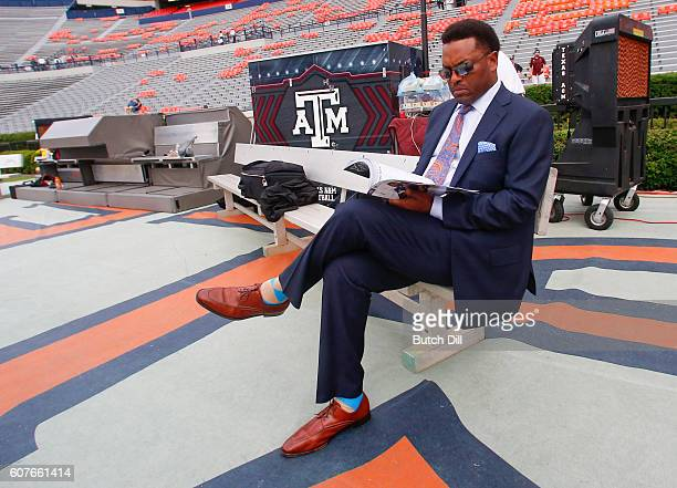 Texas AM Aggies head coach Kevin Sumlin sits on a bench looking at the game program before an NCAA college football game the Auburn Tigers on...