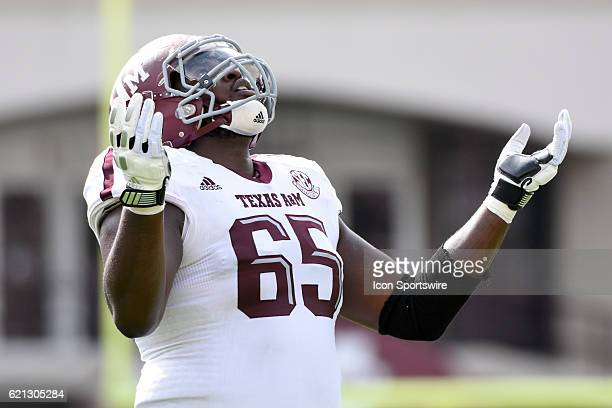 Texas AM Aggies offensive lineman Avery Gennesy looks skyward after a touchdown was upheld after review during the football game between Mississippi...