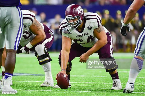Texas AM Aggies offensive lineman Erik McCoy prepares to snap the ball during the Texas Bowl between the Texas AM Aggies and Kansas State Wildcats on...