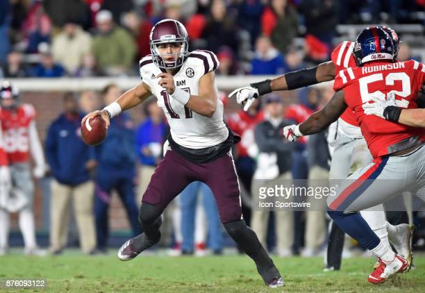 Texas AM Aggies quarterback Nick Starkel is pressured by some Mississippi Rebels defenders during the third quarter of a NCAA college football game...