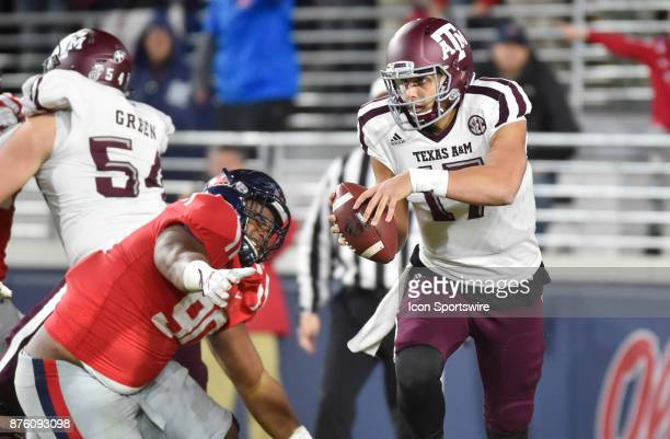 Texas AM Aggies quarterback Nick Starkel is pressured while trying to avoid a Mississippi Rebels defender during the fourth quarter of a NCAA college...