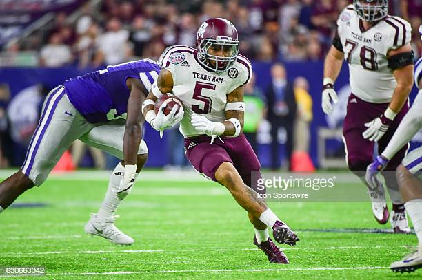 Texas AM Aggies running back Trayveon Williams finds a hole in the middle during the Texas Bowl between the Texas AM Aggies and Kansas State Wildcats...
