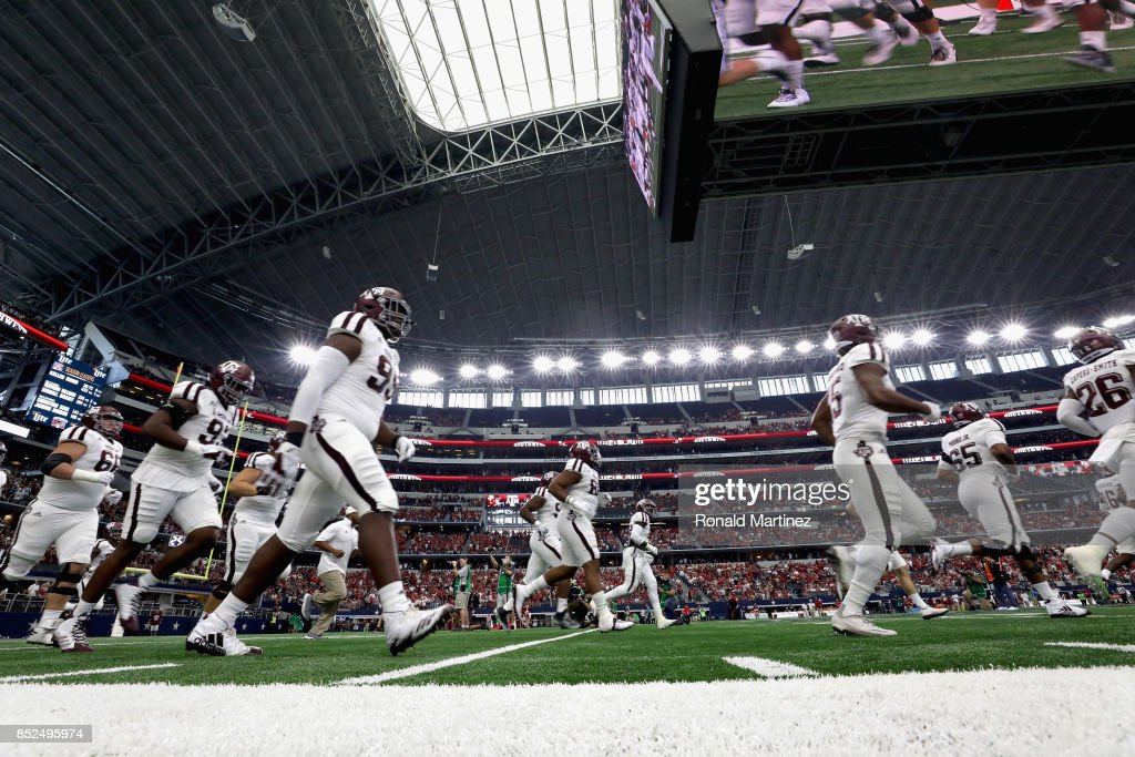 Texas A&M Aggies take the field before play against the Arkansas Razorbacks at AT&T Stadium on September 23, 2017 in Arlington, Texas.