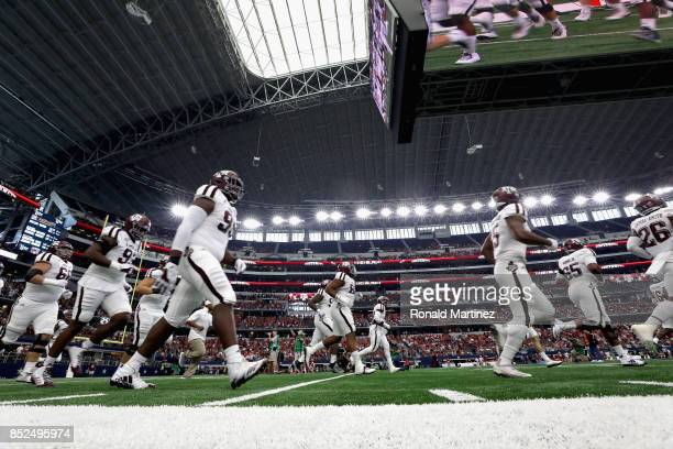 Texas AM Aggies take the field before play against the Arkansas Razorbacks at ATT Stadium on September 23 2017 in Arlington Texas